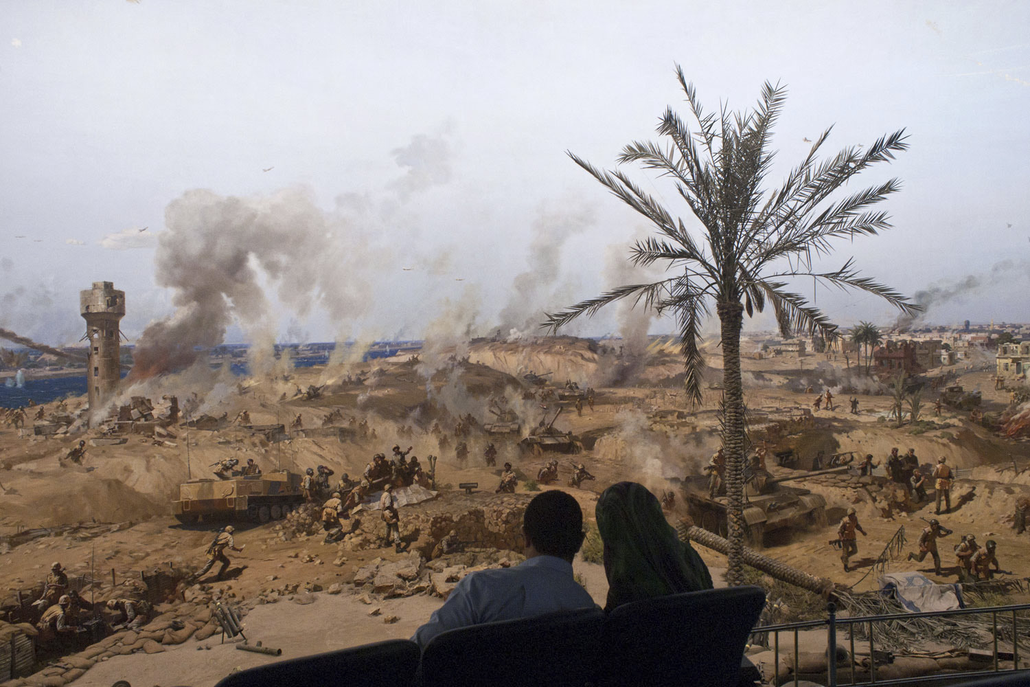 April 2, 2011. A couple sits near a panorama in Cairo depicting Egypt's war with Israel.