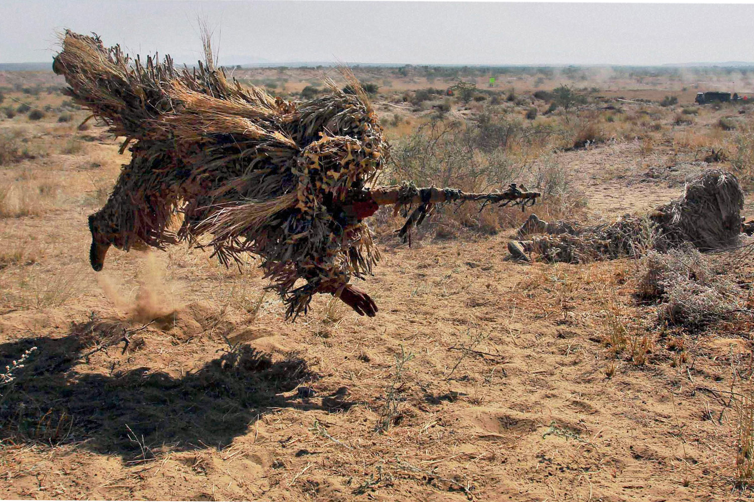 December 5, 2011. Indian army soldiers in camouflage take part in exercise  Sudarshan Shakti  at Bugundi in Rajasthan state's Barmer desert near the India Pakistan border, India.