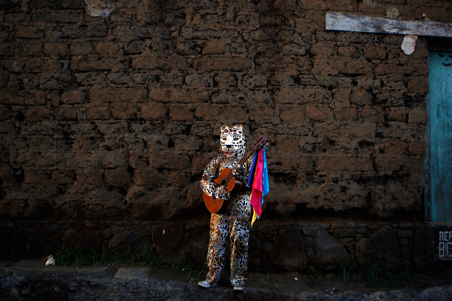 December 4, 2011. A man dressed as a jaguar holds a guitar during closing festivities in honor of Masaya's patron saint, Saint Jerome, in Masaya, Nicaragua. The festival is a three month celebration in honor of the Catholic Saint.