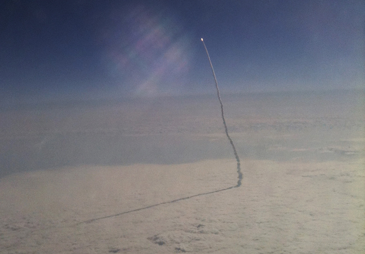 The photo [of space shuttle Endeavour] was an unexpected hit that I took from almost 35,000 ft. over Florida, flying from New York City to Palm Beach with—of all things my—iPhone 3GS, and tweeted it out upon landing,  says Stefanie Gordon.  I didn't realize the impact of the photo or the rounds it was making in social media until a few hours later when I looked at my Twitter mentions and all the personal messages I was receiving on Facebook. Next thing I knew, I was being interviewed by media outlets from all over the world, and my photo was on almost every evening news program. I am still in search for that perfect job that many thought would be offered to me after the photo caught fire.