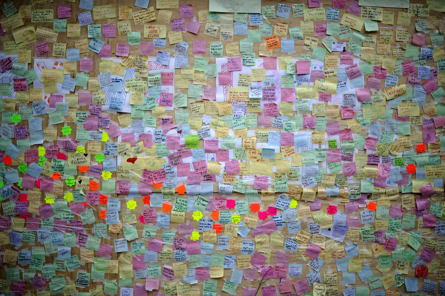 August 11, 2011. Notes are pinned up at a  Peace Wall  on a boarded-up window of a discount store in Peckham, London, following days of rioting.