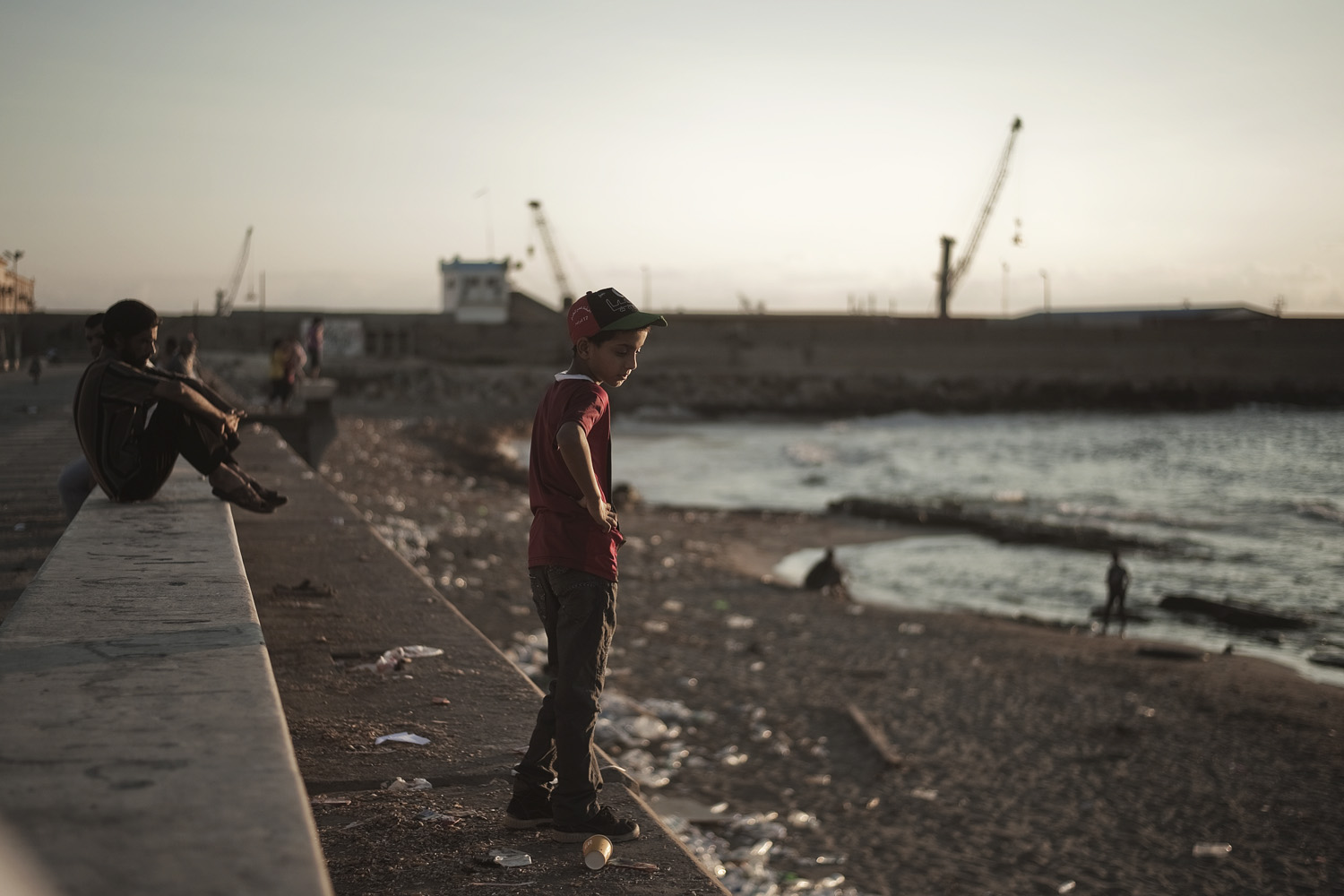August 14, 2011. A Libyan child looks at the sea on a corniche seaside in the rebel stronghold city of Benghazi.