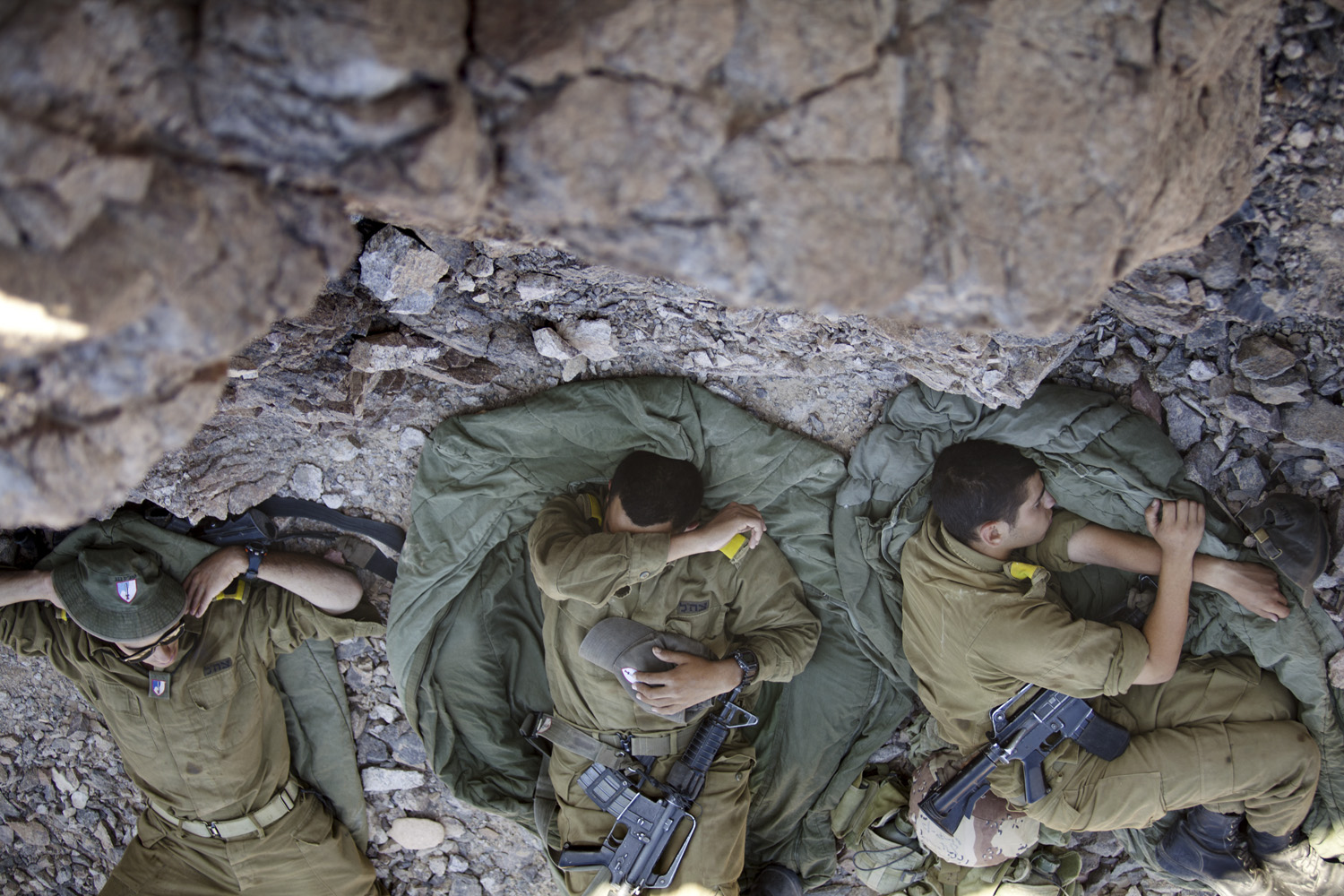 August 19, 2011. Israeli army troops rest on the Israeli-Egyptian border, following a series of coordinated gun and roadside bomb attacks against military and civilian targets north of the Red Sea town of Eilat, Israel.
