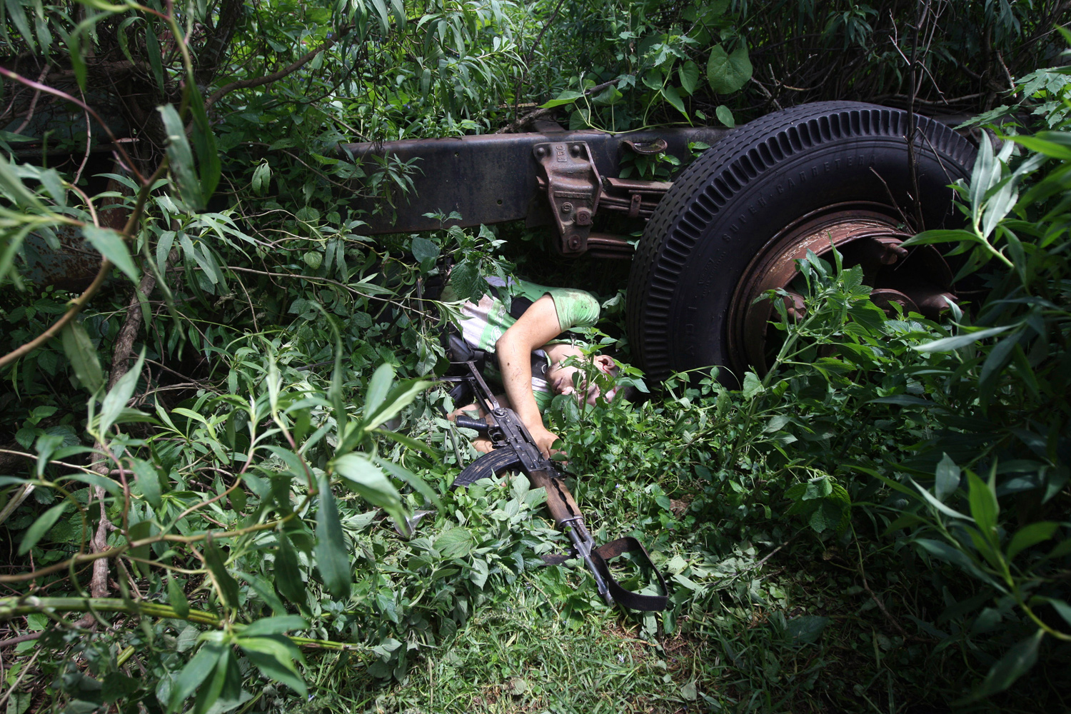 August 24, 2011. The body of a gunman lies in the woods after a shootout with soldiers in Zirahuen near Morelia, Mexico.