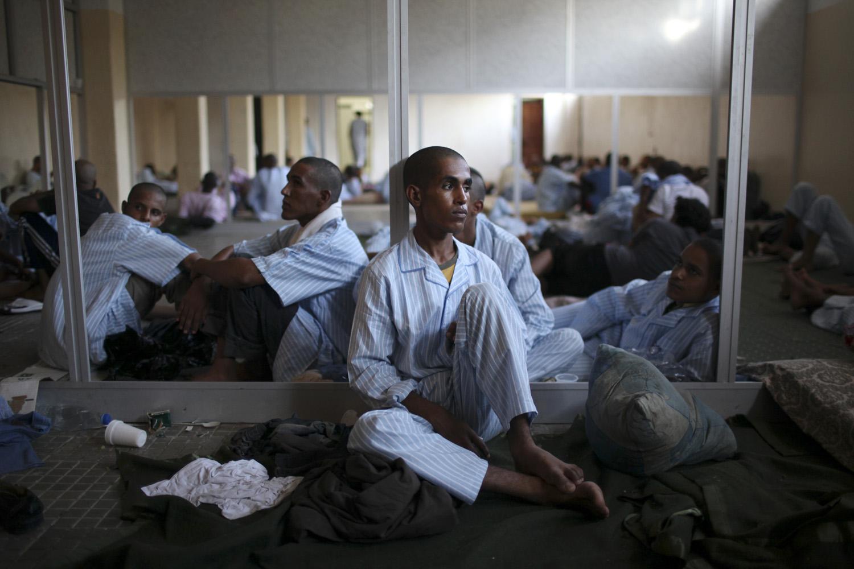 August 29, 2011. Pro-Gaddafi soldiers rest in a school-turned-prison in Tripoli, Libya.