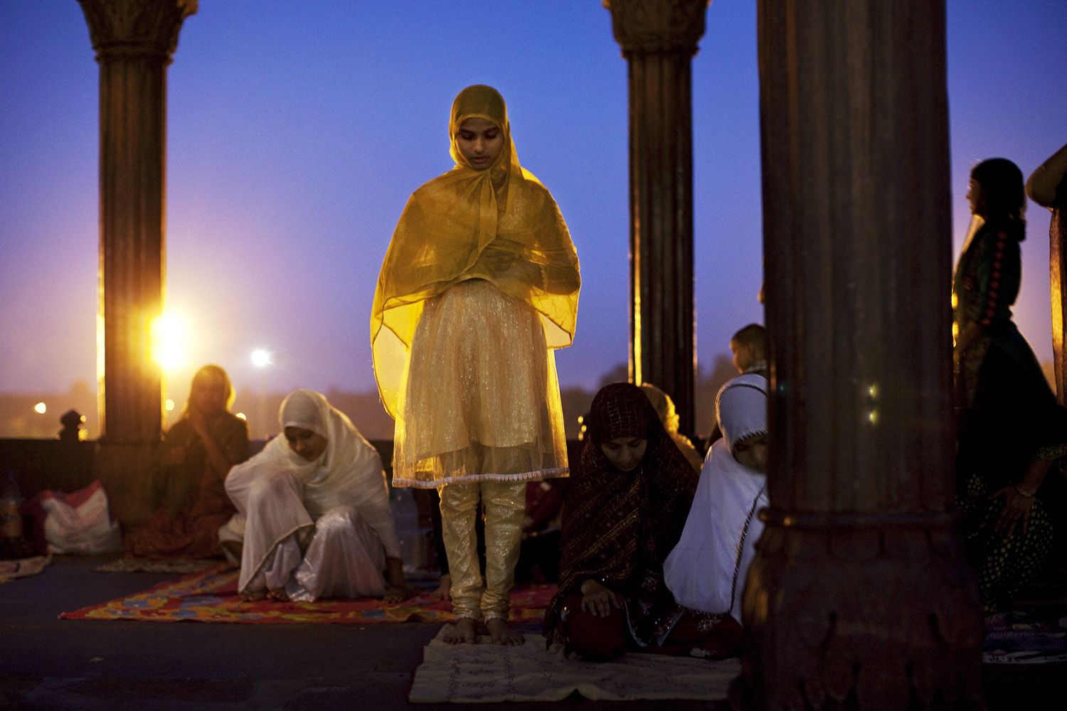 August 5, 2011. An Indian Muslim prays after breaking  the Ramadan fast at the Jama Masjid in New Delhi, India.