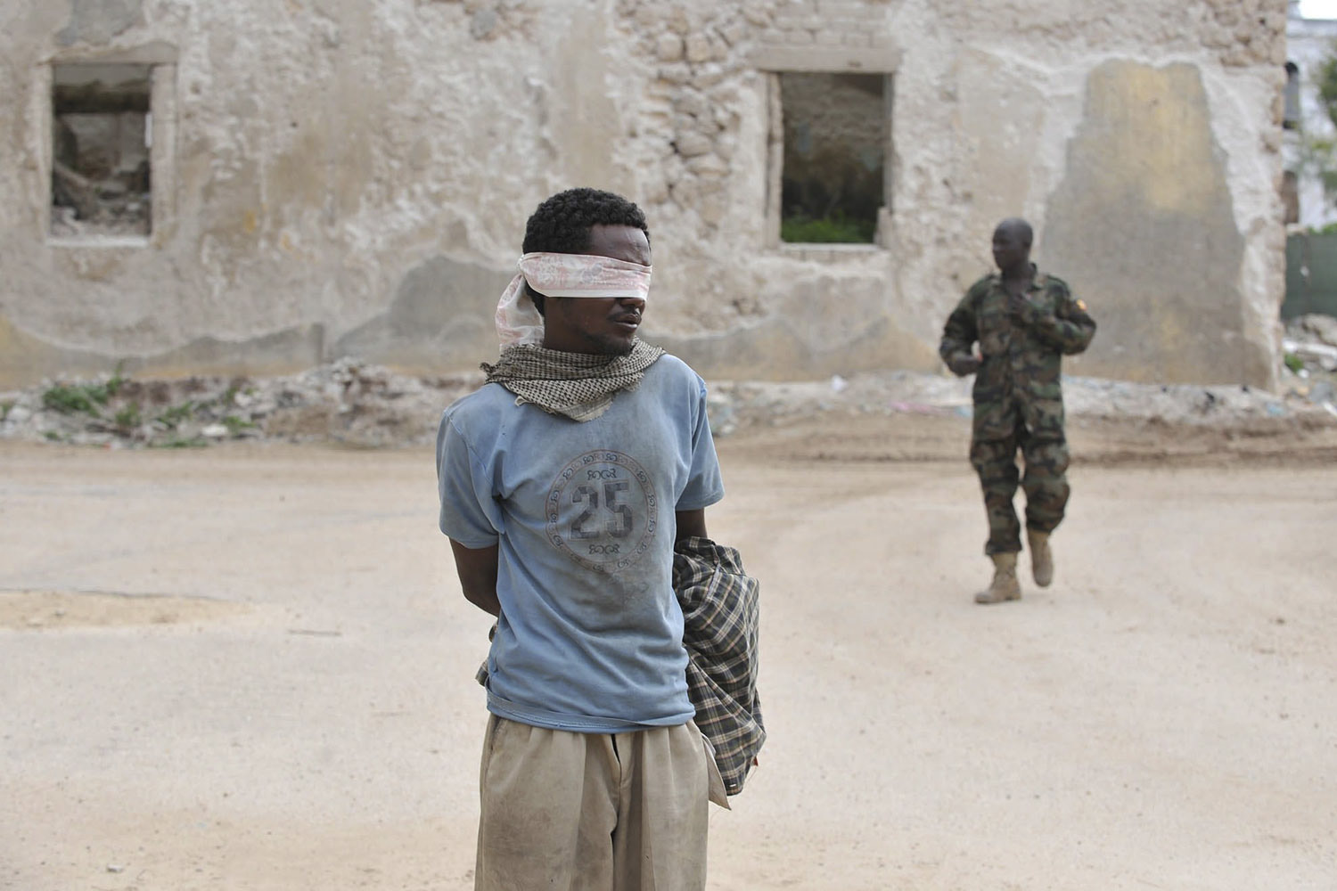 August 6, 2011. A suspected rebel member of Al-Shabab was captured by Amisom (African mission in Somalia) in Mogadishu shortly after the militant group withdrew from the last four districts that they held after heavy fighting through out the night.