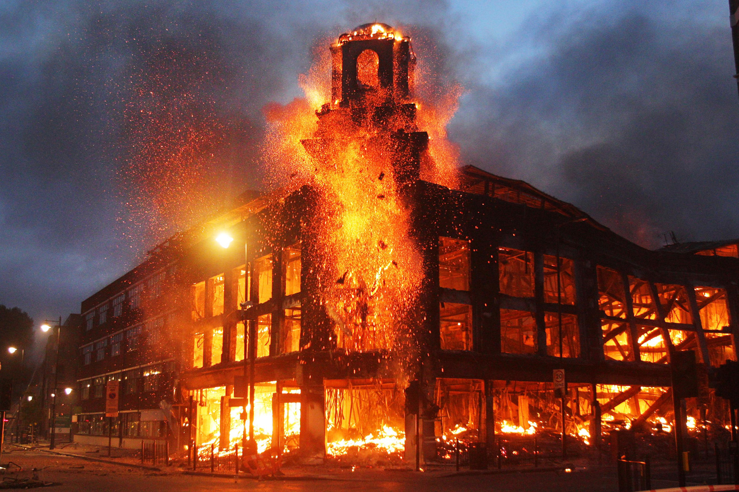 August 7, 2011. Fire rages through a building in Tottenham, north London as trouble flared after members of the community took to the streets to demand  justice  after Mark Duggan, 29, was shot dead by police.