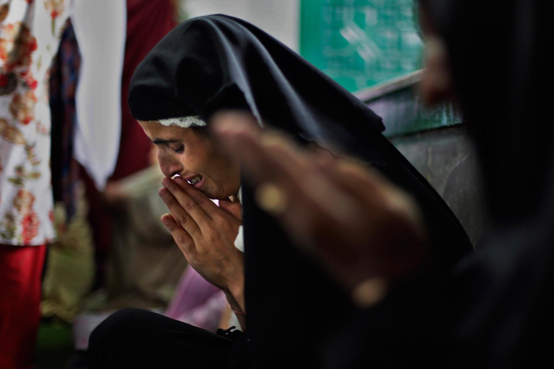 August 8, 2011. A Kashmiri Muslim woman cries as she prays at Shah-e Hamdan mosque in Srinagar, India.
