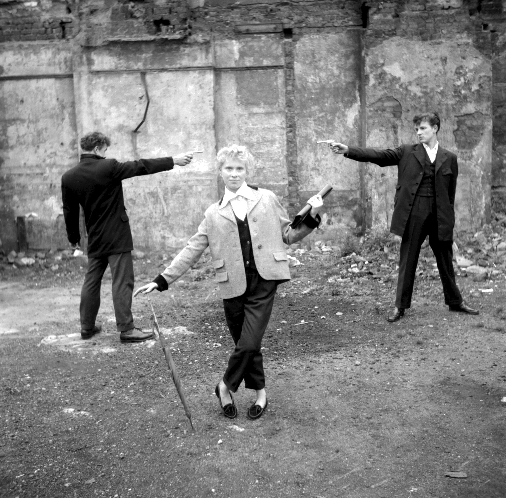 16-year-old Eileen from Bethnal Green, with two teddy boys  duelling  over her on an East End bombsite.