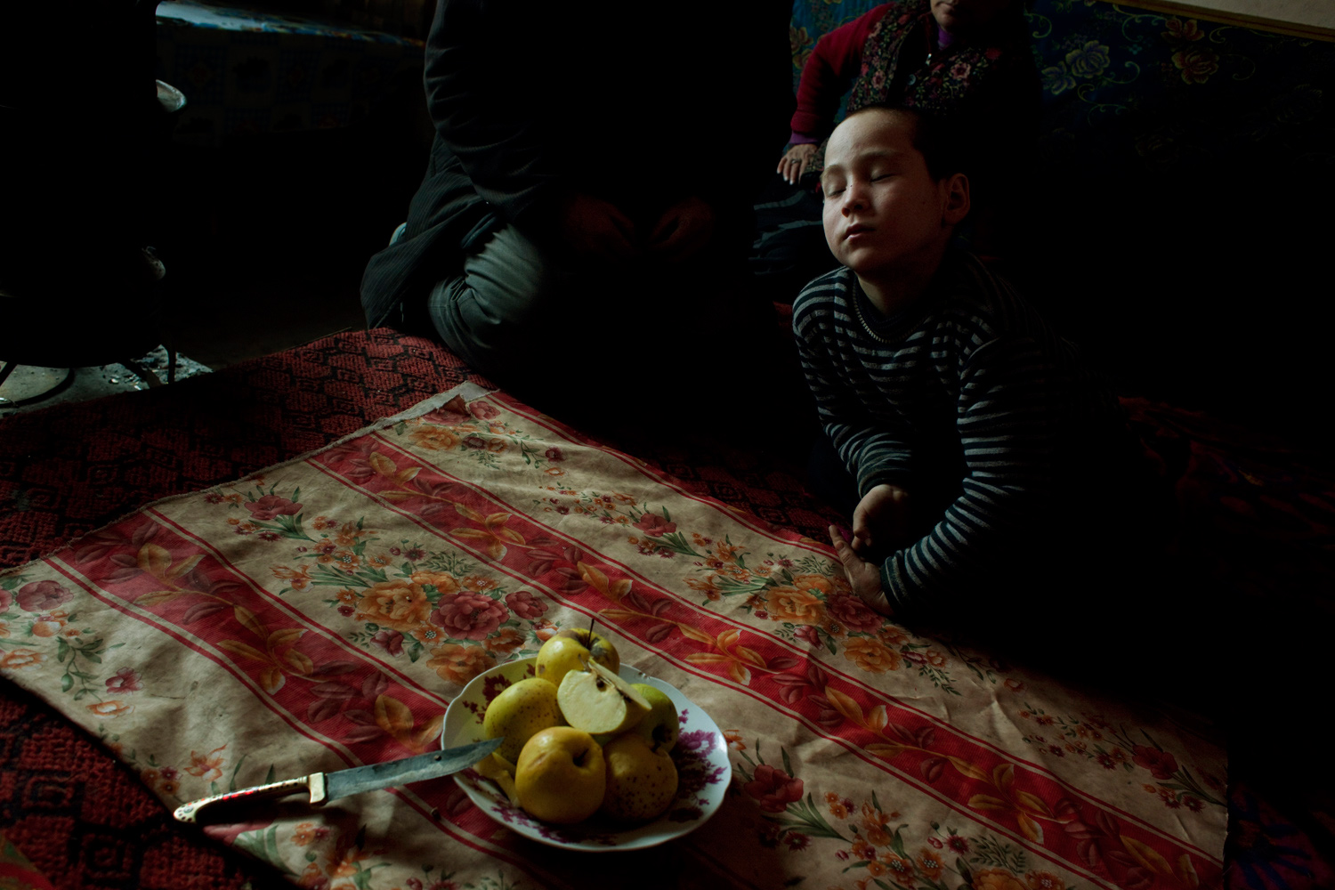 February 13, 2011. An Uyghur citizen waits for lunch in a farmhouse.