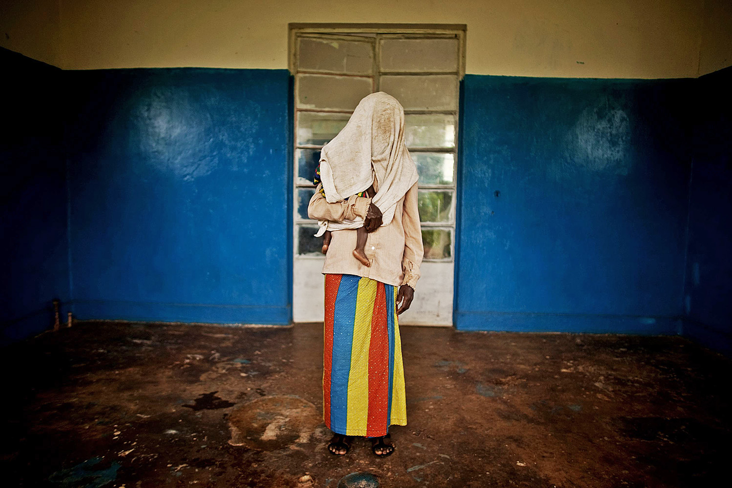 February 20, 2011. A victim of a mass rape campaign in the town of Fizi, Democratic Republic of Congo. Her identity has been concealed for security reasons and because rape carries strong social stigma in the nation.
