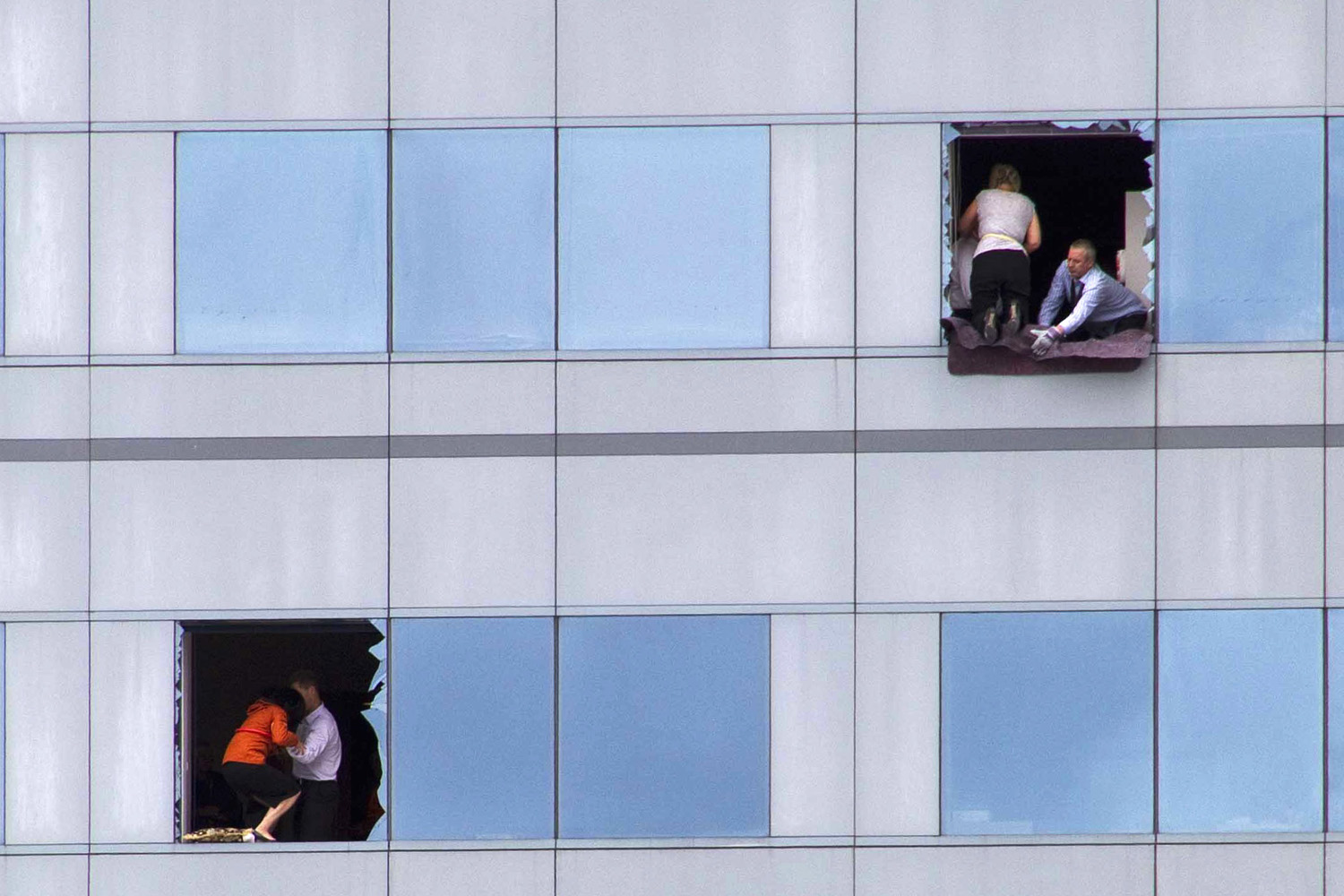 February 22, 2011. Office workers look for a way out of a high-rise building in central Christchurch. A strong earthquake killed at least 65 people in New Zealand's second-biggest city in February.