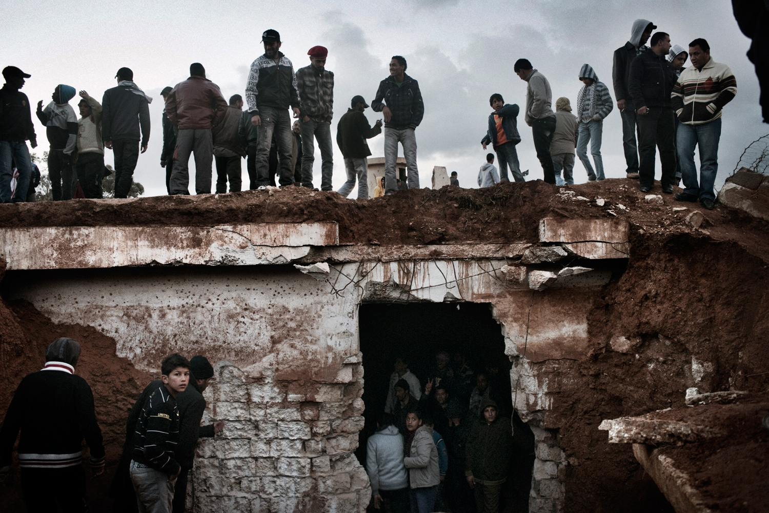 February 24, 2011. Demonstrators drilled into this jail to look for prisoners in a compound belonging to government security forces in Benghazi, Libya.