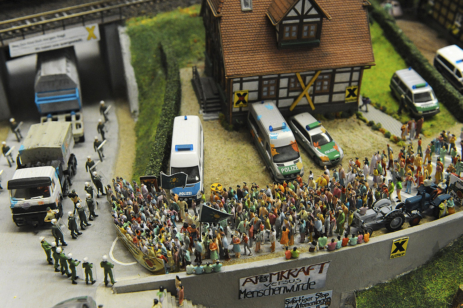 February 5, 2011. Miniature model railway landscape shows a demonstration scene as part of the Castor protest events in Stadthagen, Germany. A group of students built this miniature landscape, which is inspired by the real events of the anti-nuclear protests against the Castor nuclear transport.