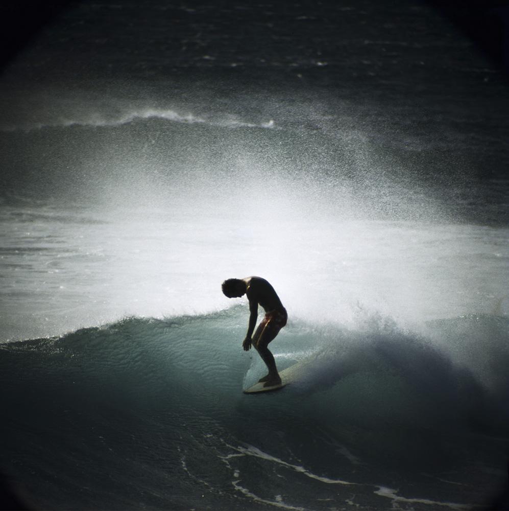 Midget Farrelly surfing a  shorebreak in Makaha, Hawaii, 1968, in an image taken by LeRoy Grannis.
