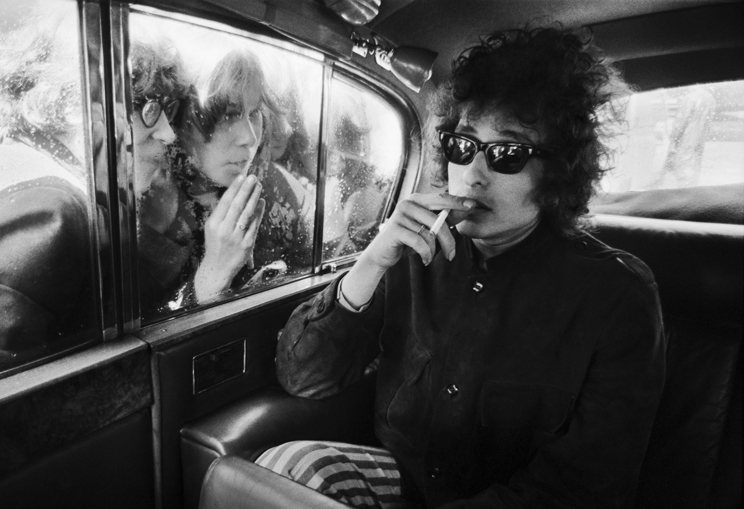 Barry Feinstein's photograph of musician Bob Dylan and fans, take in London in 1966.
