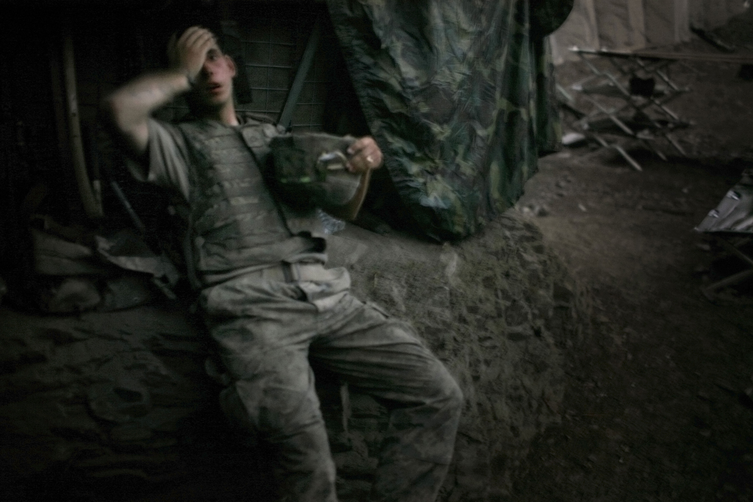 Tim Hetherington's image of a soldier from 2nd platoon as he rests at the end of a day of heavy fighting at the 'Restrepo' outpost in Korengal Valley, Afghanistan, 2007.