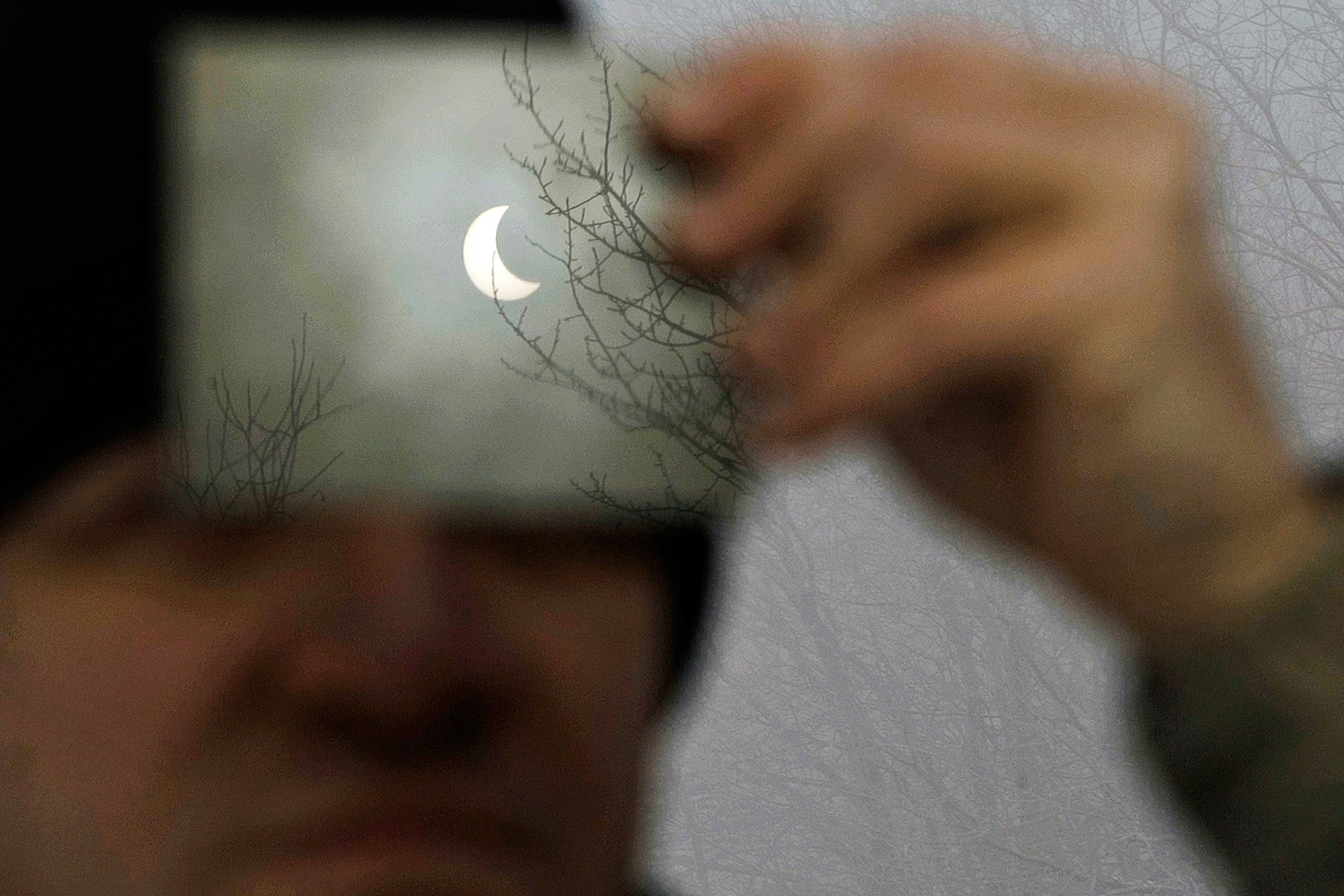 January 4, 2011. A man watches a partial solar eclipse through a filter in Galyateto, some 100 km (62 miles) east of Budapest.