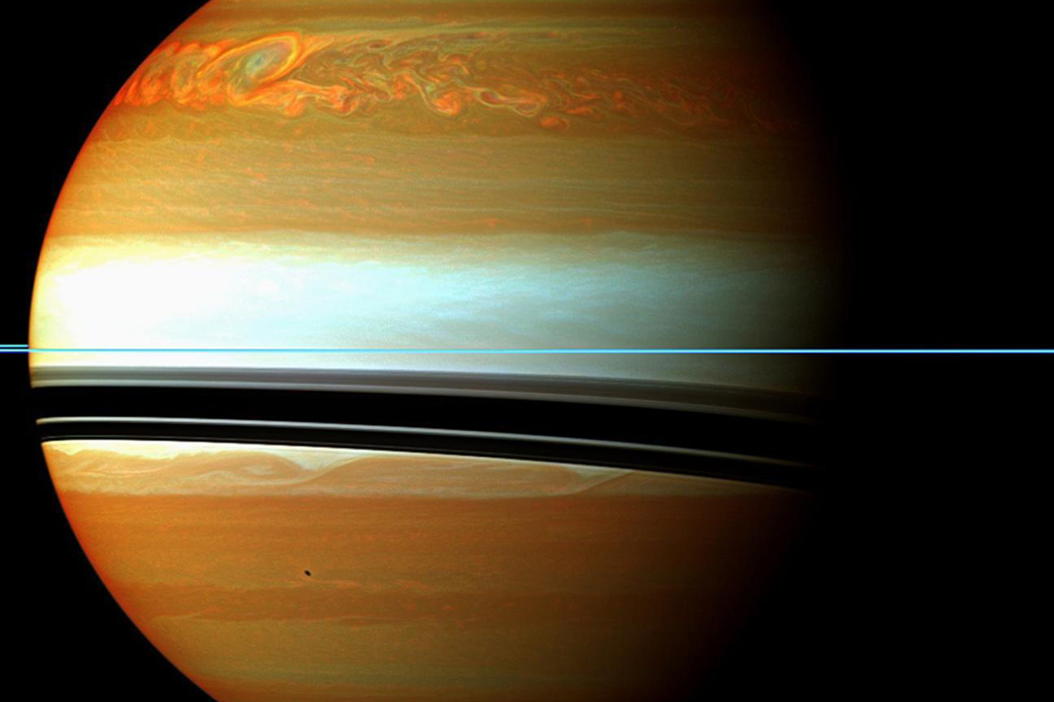 January 12, 2011. A false-color mosaic showing the tail of Saturn's huge northern storm. Red and orange colors in this view indicate clouds that were deep in the atmosphere.