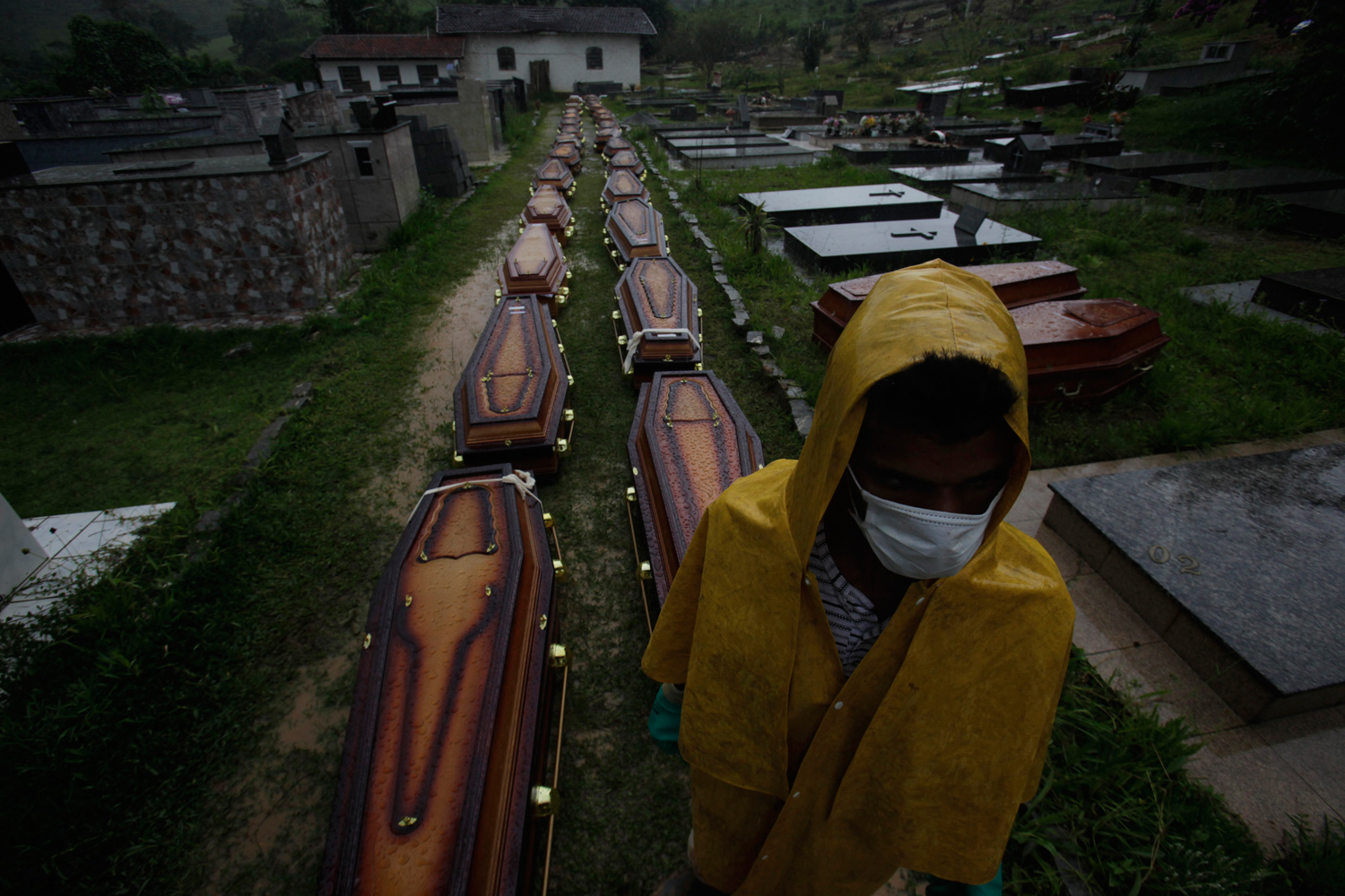 Janurary 15, 2011. A worker stands next to coffins of victims of landslides at a cemetery in Nova Friburgo. Nearly four days after rains sparked floods and massive landslides, officials in the Brazilian town of Teresopolis were still struggling to cope with the catastrophe that killed at least 564 people in the region north of Rio de Janeiro.