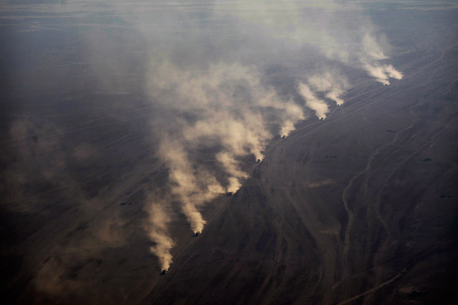 January 21, 2011. In this aerial, A NATO military re-supply convoy kicks up dust in the desert as seen from a medevac helicopter of the U.S. Army's Task Force Shadow  Dust Off , Charlie Company 1-214 Aviation Regiment in the volatile Helmand Province of southern Afghanistan.