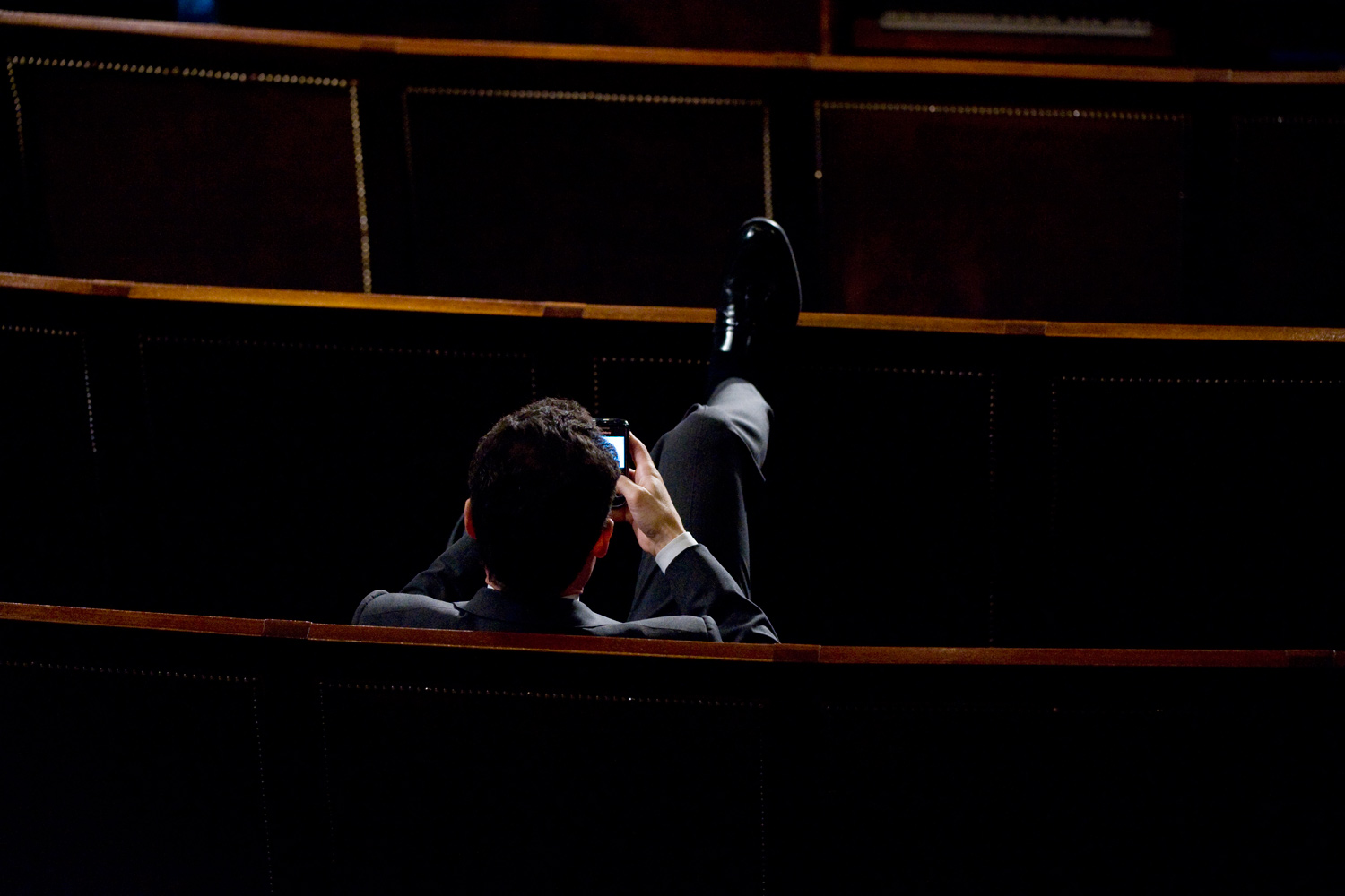 January 25, 2011. Rep. Anthony Weiner, D-N.Y., works on his Blackberry after President Barack Obama's State of the Union address in the House Chamber.  Many Senators and Representatives from opposite sides of the aisle chose to sit with each other to help alleviate partisanship.