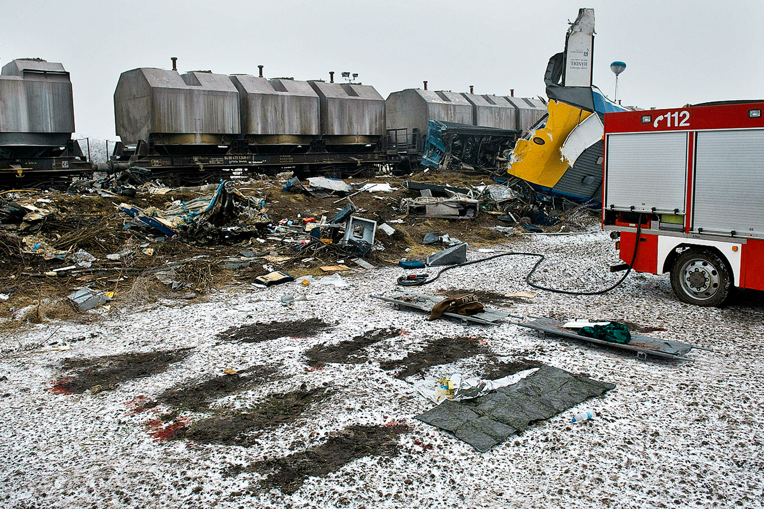 January 30, 2011. The outline of 10 bodies, the casualtieso f a train crash, are seen in the melted snow on the scene of the accident in Hordorf, Germany.