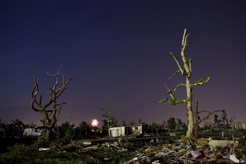 July 2, 2011. In tornado-ravaged Joplin, Missouri, residents light July 4 fireworks amid the ruins of their community.