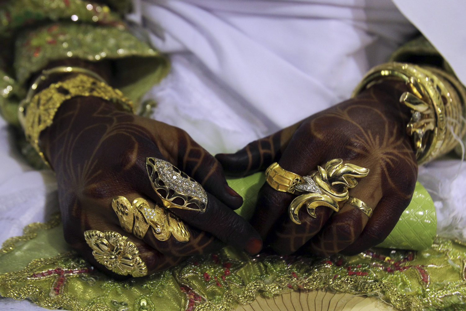 July 7, 2011. A Libyan bride is pictured during a group wedding party held for 25 couples in support of Muammar Gaddafi at his Bab al-Aziziya compound in Tripoli.
