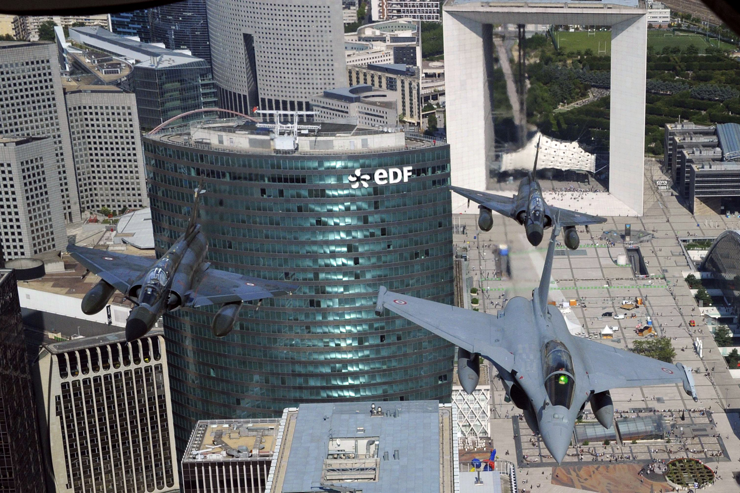 July 14, 2011. A French Rafale jet (R) flanked by two Mirage 2000-N flies over La Defense district in western Paris during the Bastille Day military parade.