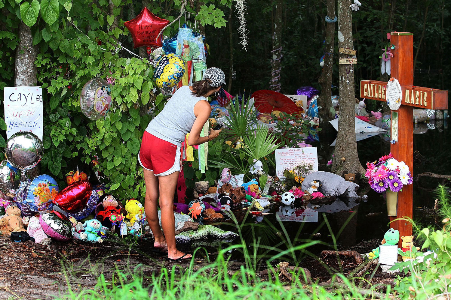 July 16, 2011. A woman pays a visit to the Caylee Anthony memorial located at the site in Orlando where the 2-year-old child's remains were found in December 2008.