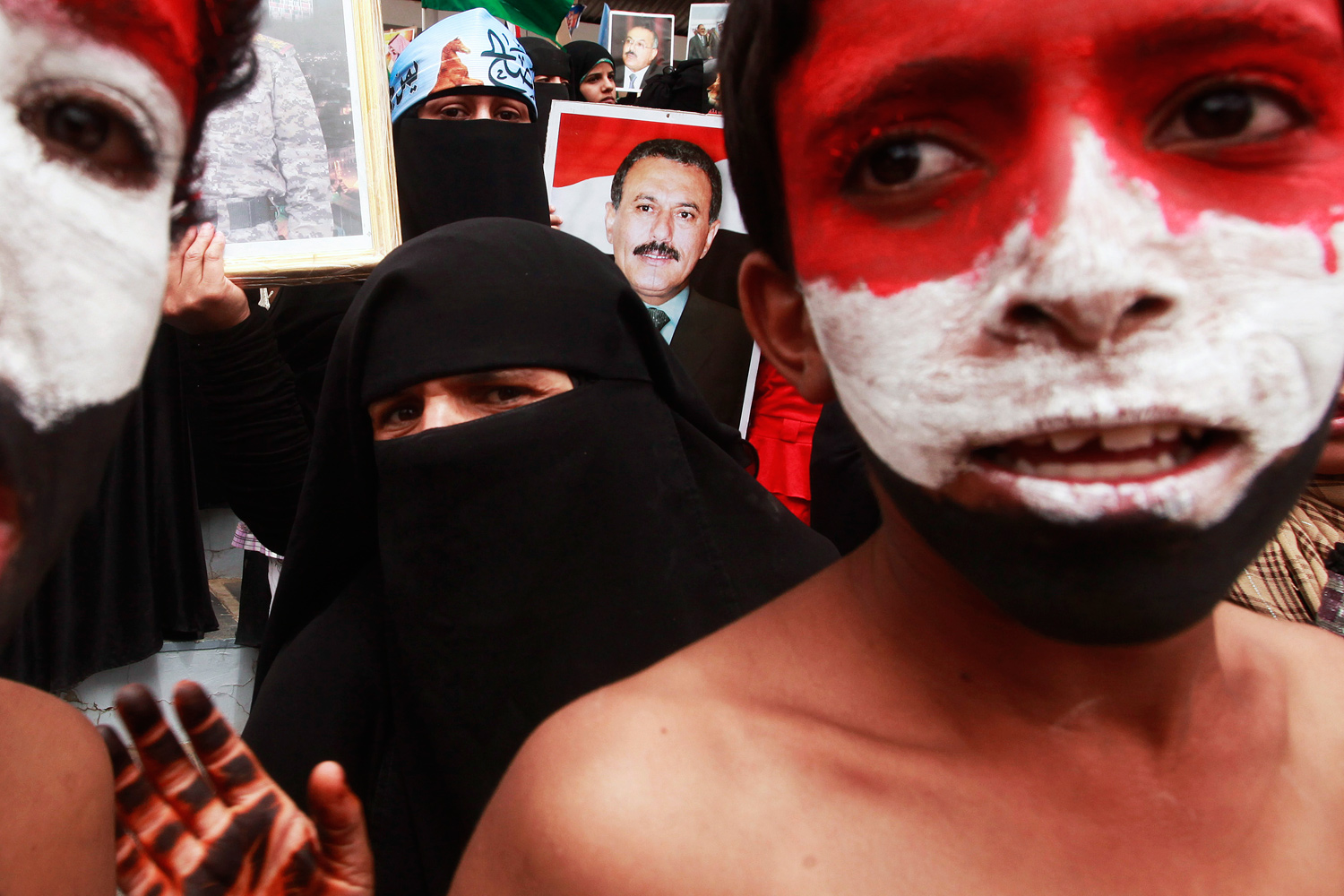 July 22, 2011. Supporters of Yemen's President Ali Abdullah Saleh attend a rally after painting their faces with the Yemeni flag colors following Friday prayers in Sana'a.
