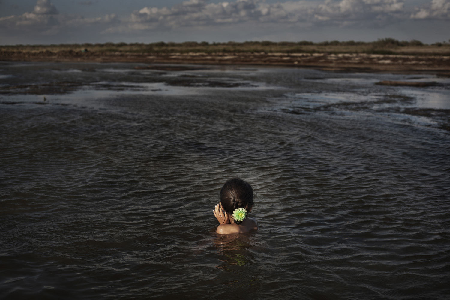 July 24, 2011. Madina, 7, bathes in the Aral Sea on her third trip to the sea visiting family friends.