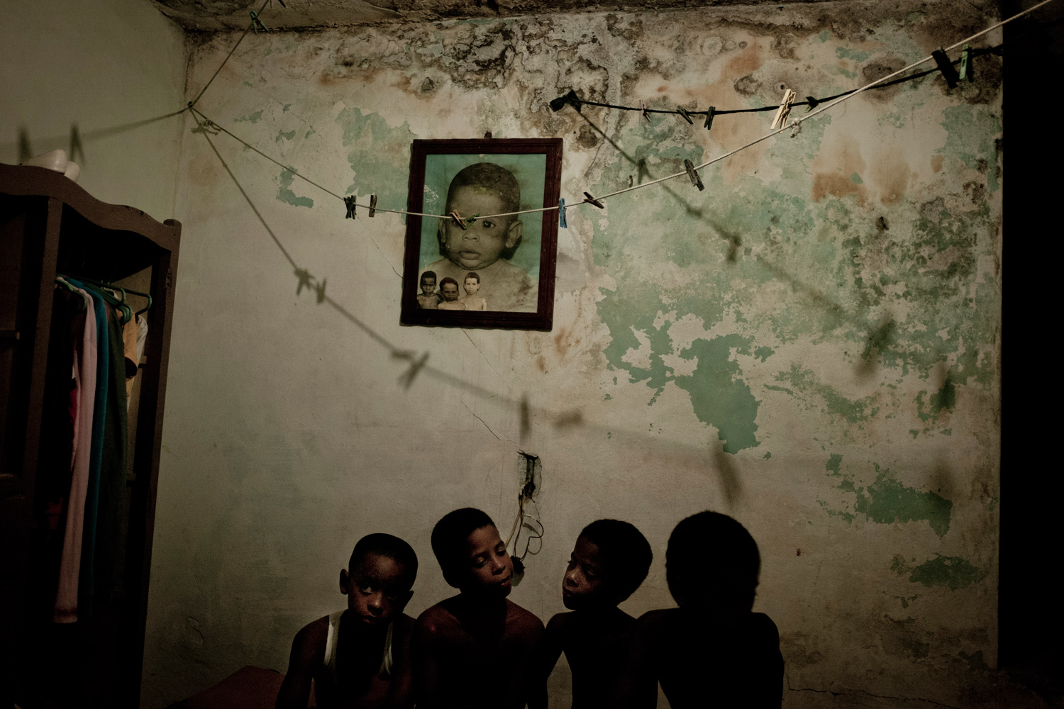 July 26, 2011. Four brothers from the Morales family in their room in centro Havana, Cuba.