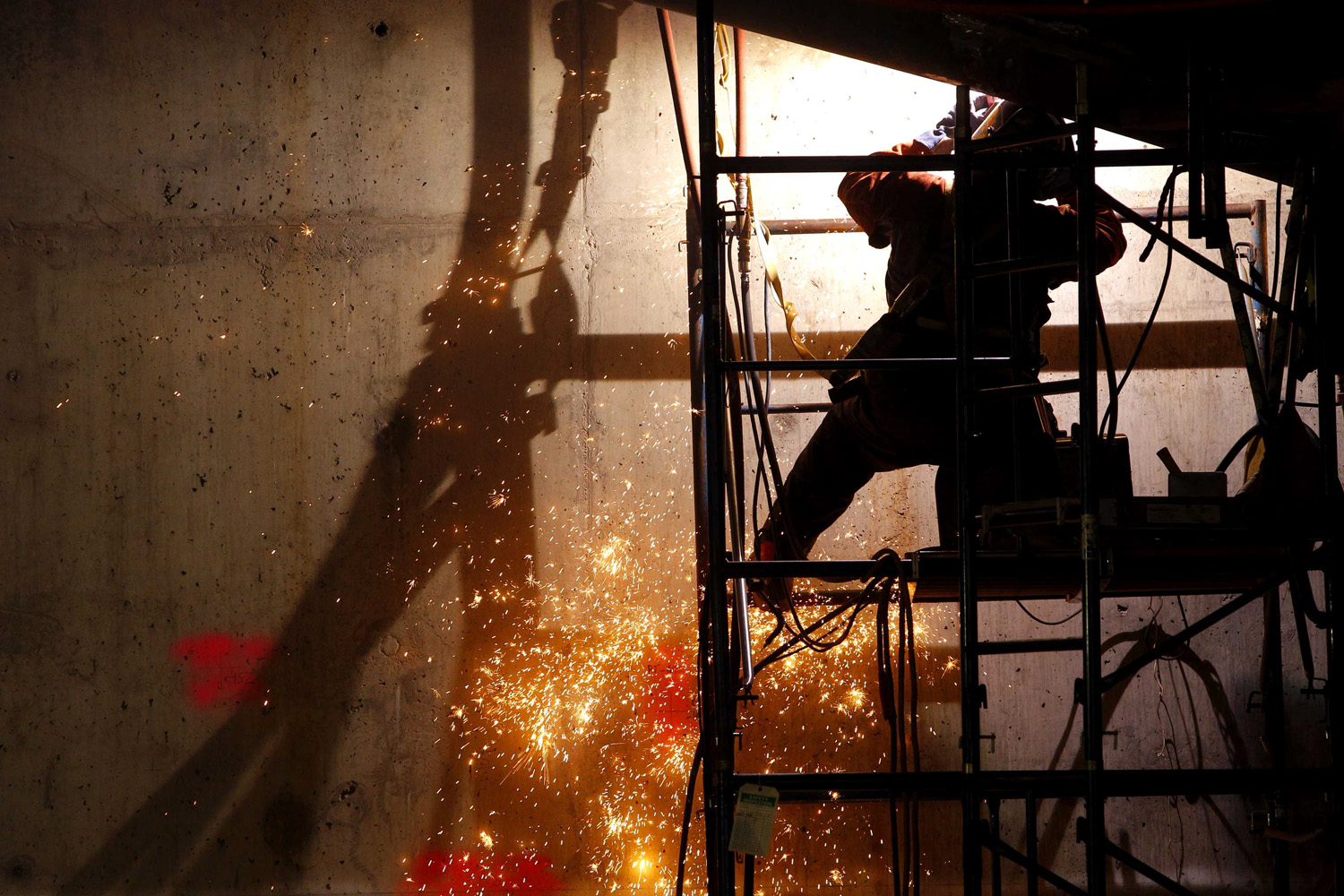 July 28, 2011. A welder works below ground level as work continues on the National September 11 Memorial and Museum at the World Trade Center site in New York. The memorial was dedicated on September 11, 2011, the 10th anniversary of the attacks on the World Trade Center.
