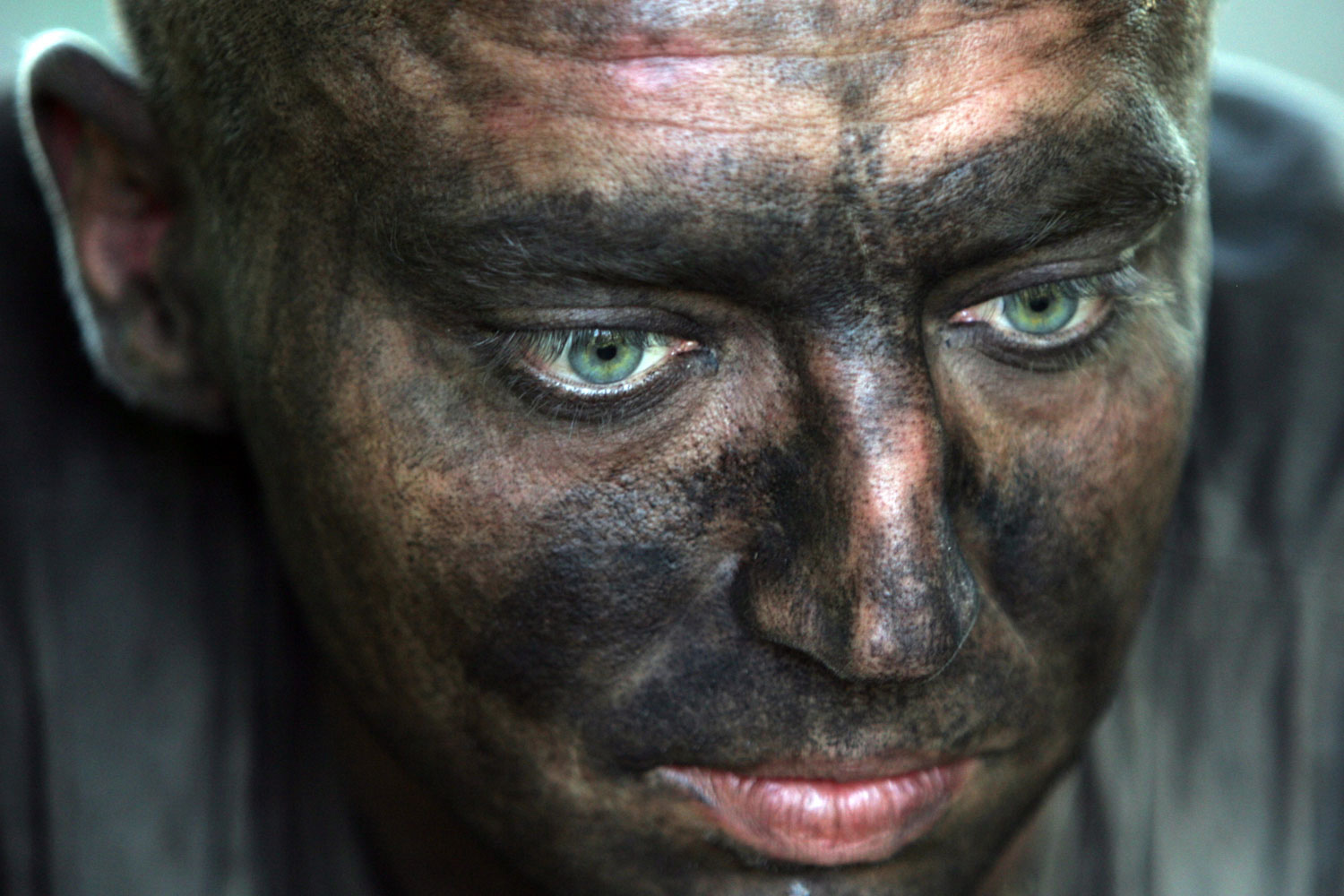 July 29, 2011. A rescuer rests during a break at Sukhodolskaya-Vostochnaya coal mine in the Lugansk region of eastern Ukraine. Eighteen miners died and another 20 were missing after an explosion in the coal mine.