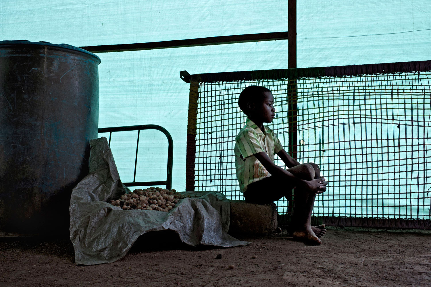 June 21, 2011. Raby, 8 years old, sits at the transit center of Wau, Northern Bar el Ghazal in South Sudan.