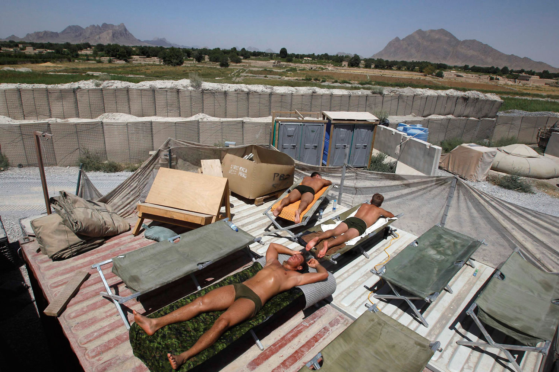 June 22, 2011. Canadian army soldiers sun bathe in Seprwan Ghar foward fire base in the Panjwai district of Kandahar, Afghanistan.