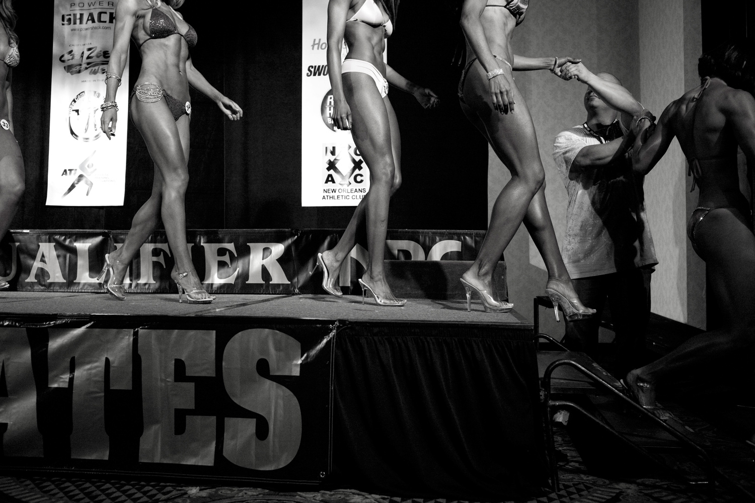 June 25, 2011. Women exiting the stage after the bikini judging at the IBBPro Greater Gulf States bodybuilding competition.