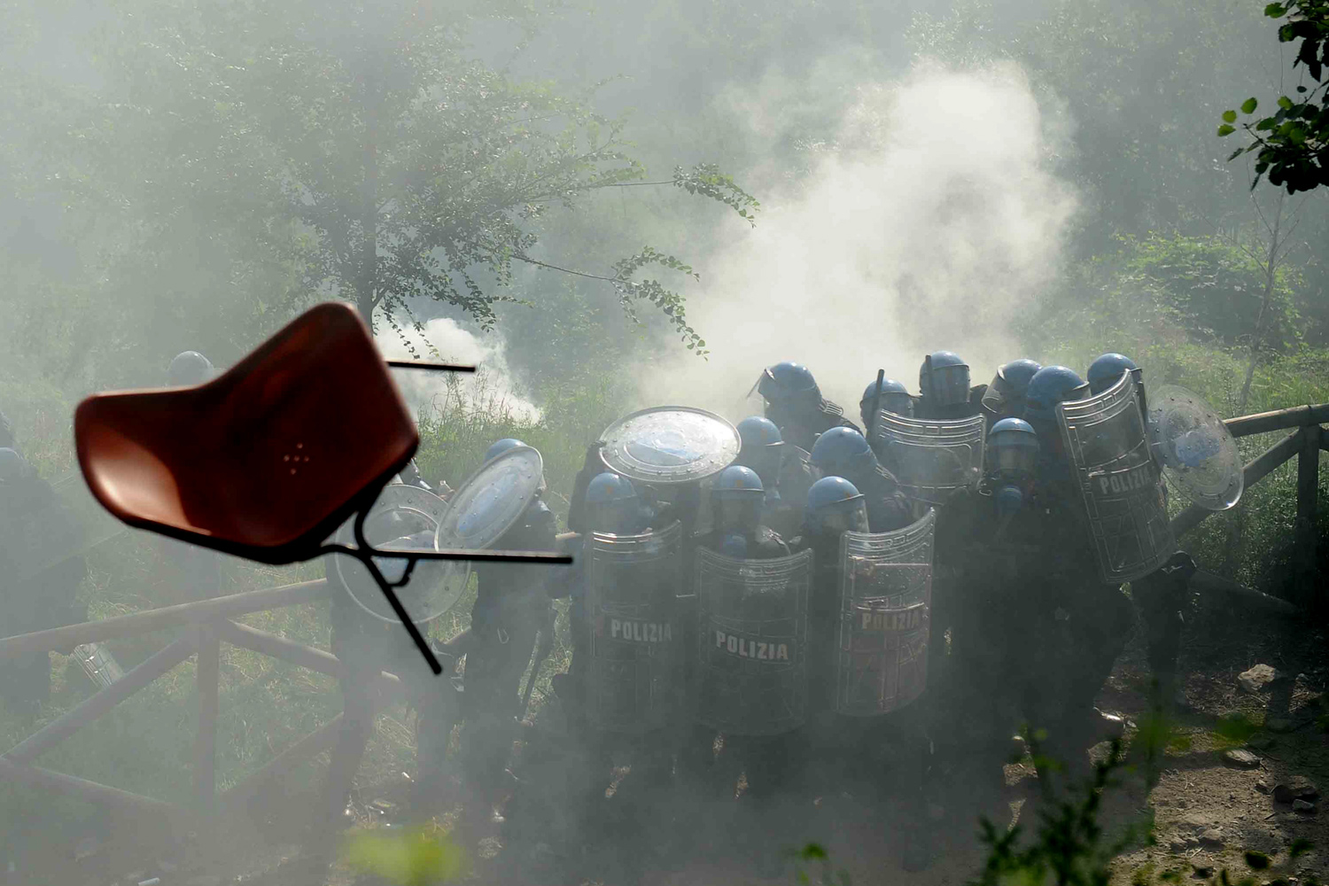 June 27, 2011. Italian police officers in riot gear clash with demonstrators in Chiomonte, Italy, over plans to build the Turin-Lyon high-speed train.