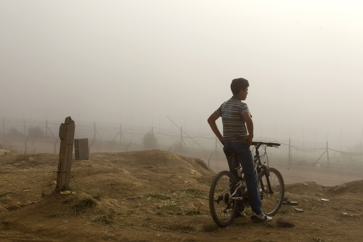 June 6, 2011. A boy sits on his bicycle in Majdal Shams, Israel, near Israel's border with Syria.