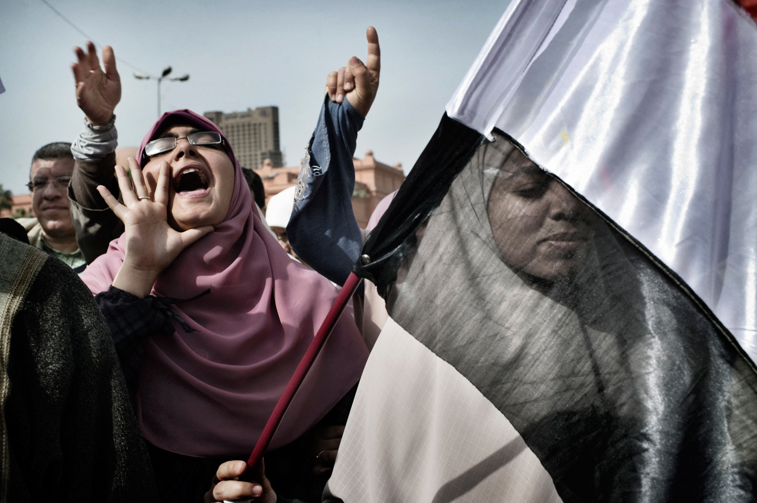 Cairo, Egypt —February 4, 2011                   After repelling pro-regime attacks in two days of bloody street fights, tens of thousands of anti-Mubarak protesters packed central Cairo, waving flags and singing the national anthem.