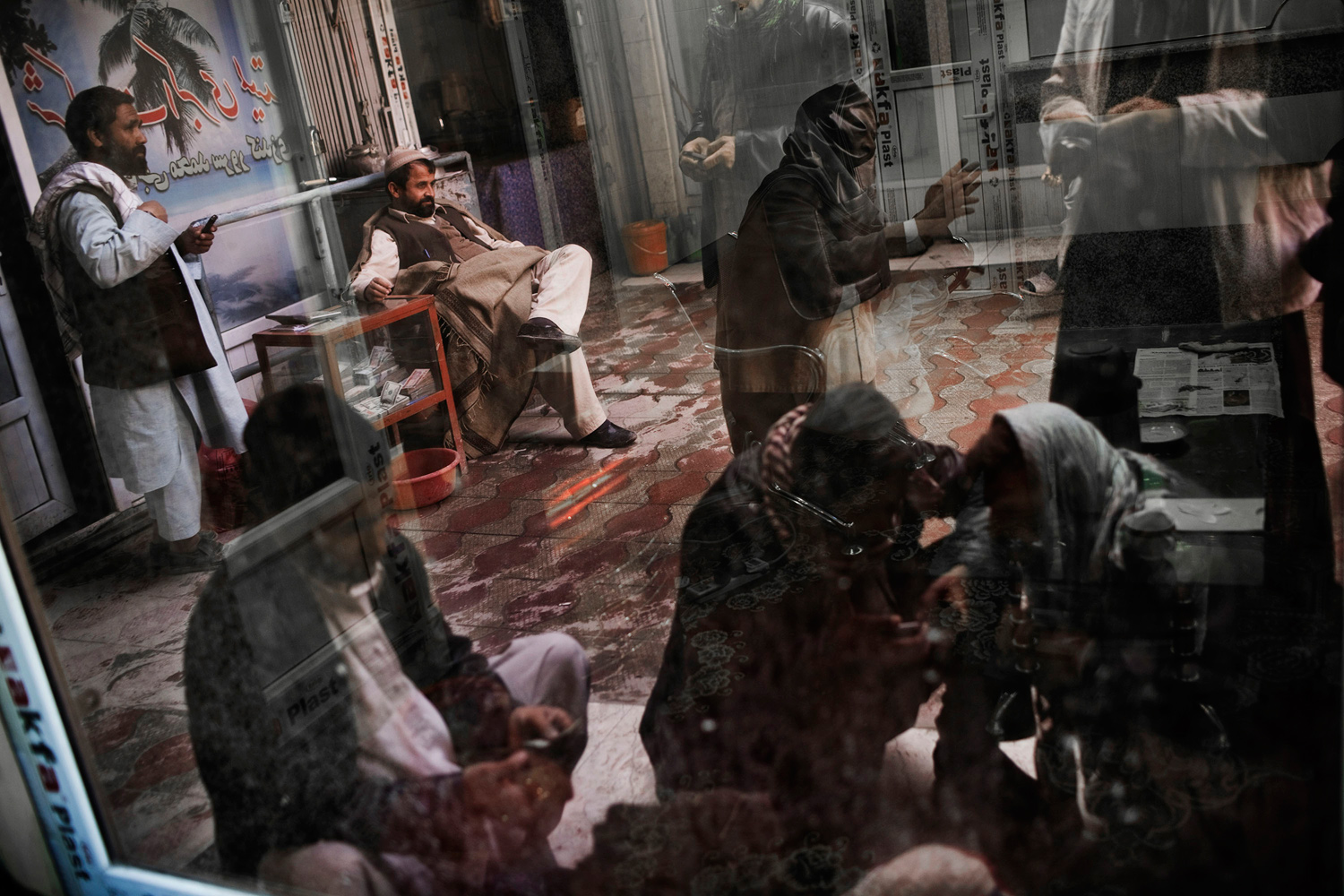 March 10, 2011. Afghan money changers and customers do business in the Sarai Shahzada Money Market in Kabul, Afghanistan.