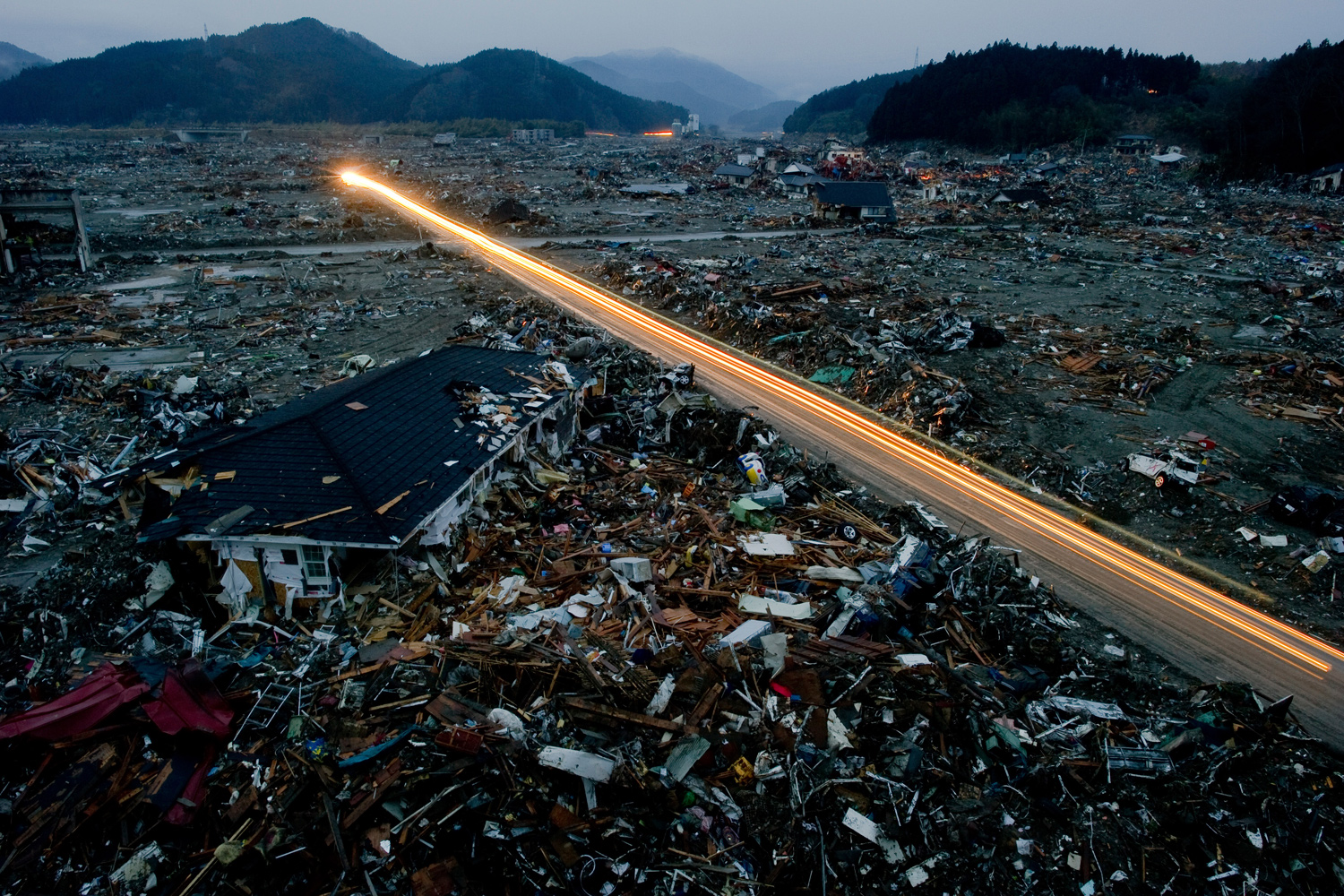 March 22, 2011. A general night view taken with a longer exposure, shows destroyed houses and debris in the tsunami-damaged city of Rikuzentakata, in Japan's Iwate prefecture.