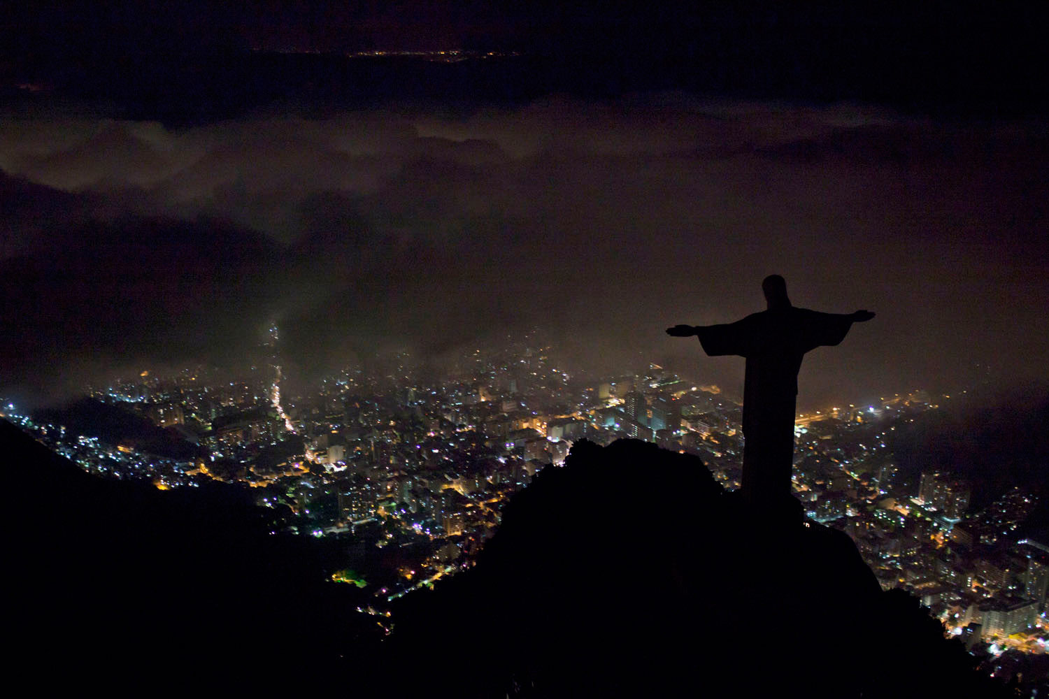 March 29, 2011. The iconic Christ the Redeemer statue stands in darkness after the lights that illuminate it were switched off to observe an hour of voluntary darkness for the global  Earth Hour  campaign in Rio de Janeiro, Brazil.