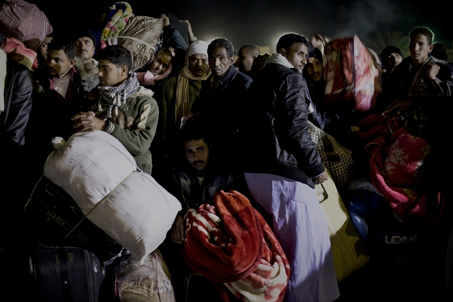 March 28, 2011. Refugess wait for hours to be let through the border of Libya and Tunisia in Ras Ajdir. Refugees flooded the western border of Libya after weeks of unrest and the threat of civil war plagued the country.