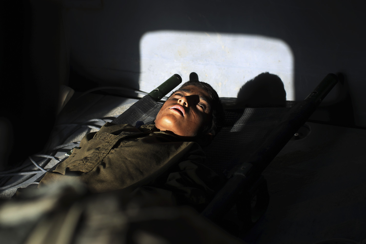 May 11, 2011. A young Afghan boy who was shot in the stomach lays on a stretcher as he is taken to hospital in a medevac helicopter in the volatile Helmand Province of southern Afghanistan.