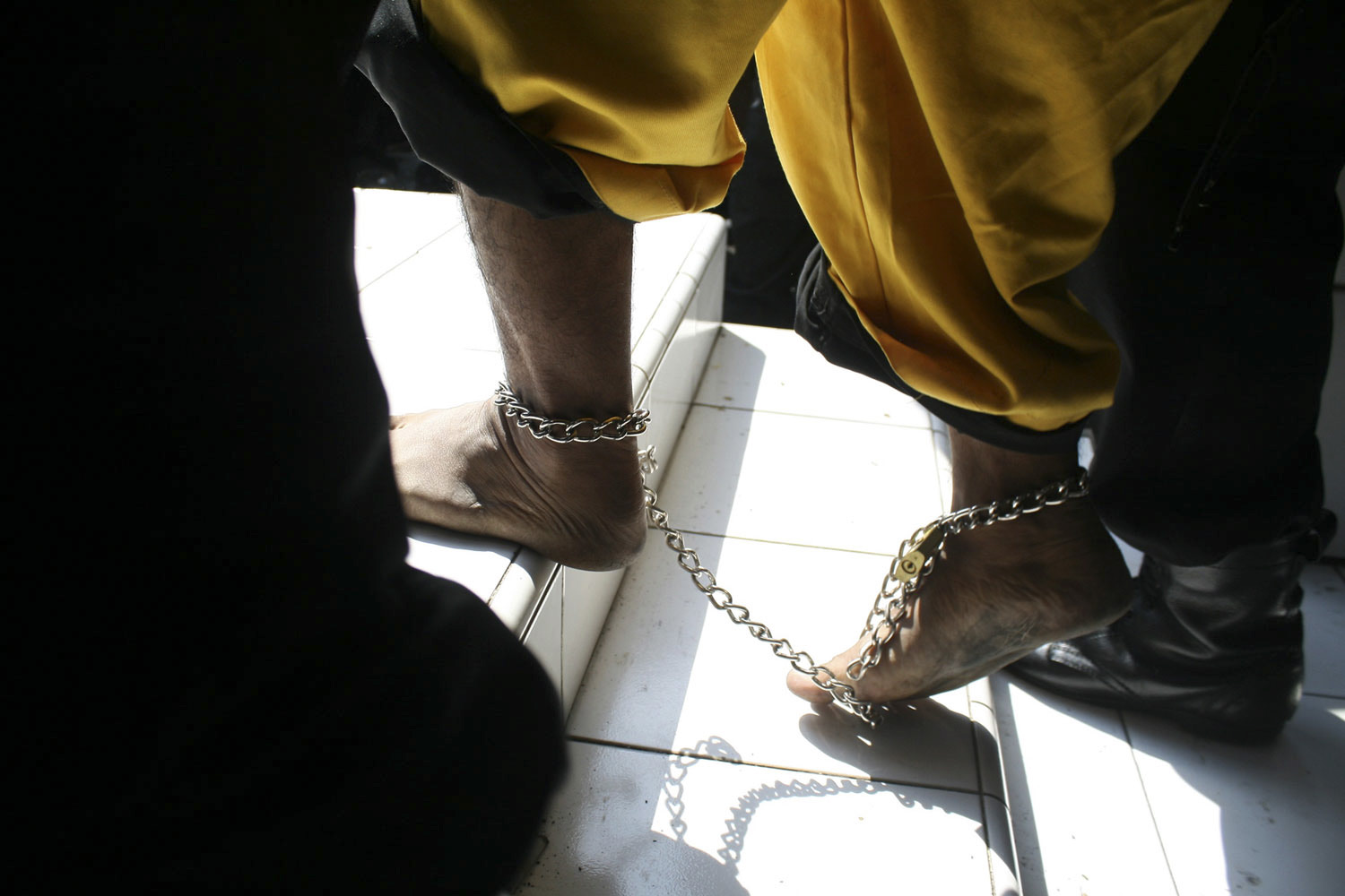 May 19, 2011. A man suspected of having ties to a suicide bomber walks at a police office in Cirebon, Indonesia.