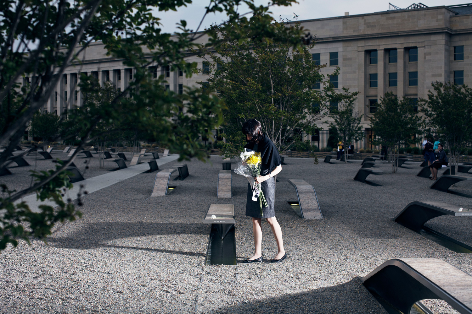 May 2, 2011. Michelle Hindmarch, of Arlington, Virginia, places flowers at the Pentagon's 9/11 Memorial just hours after President Obama announced the death of Osama bin Laden.